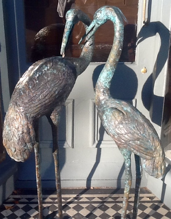 Pair of Bronze Herons